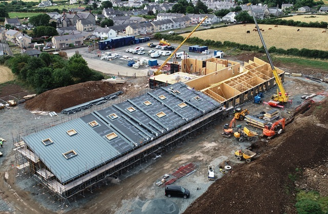 Pupils and parent learn about primary school now under construction